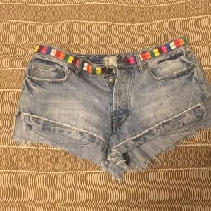 Free People jean shorts with rainbow belt